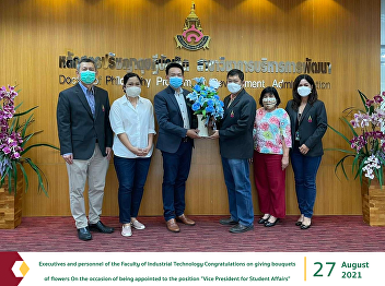 Executives and personnel of the Faculty of Industrial Technology Congratulations on giving bouquets of flowers On the occasion of being appointed to the position